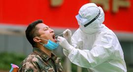בדיקת קורונה בסין, צילום: איי אף פי