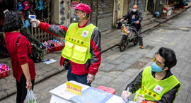 וירוס נגיף קורונה עמדת בדיקת חום בעיר גואנגג'ואו סין, צילום: אי פי איי