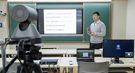 שיעור מקוון באוניברסיטת פקינג בבייג'ינג, צילום: TNS