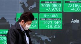 וירוס קורונה בורסה אסיה איש במסכה טוקיו יפן, צילום: איי אף פי