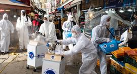 וירוס נגיף קורונה חיטוי שוק סיאול דרום קוריאה, צילום: אי פי איי