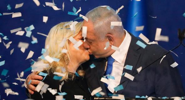 Likud Leader Benjamin Netanyahu and wife Sara celebrating. Photo: AP