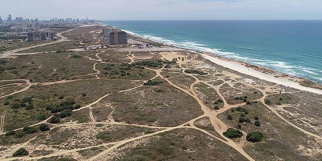 חוף התכלת ים זירת הנדלן