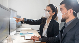 Office workers wearing masks. Photo: Shutterstock