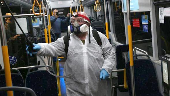 A bus in Israel getting disinfected. Photo: Motti Kimchi