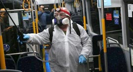 Cleaning the bus in Israel because of coronavirus. Photo: Motti Kimchi