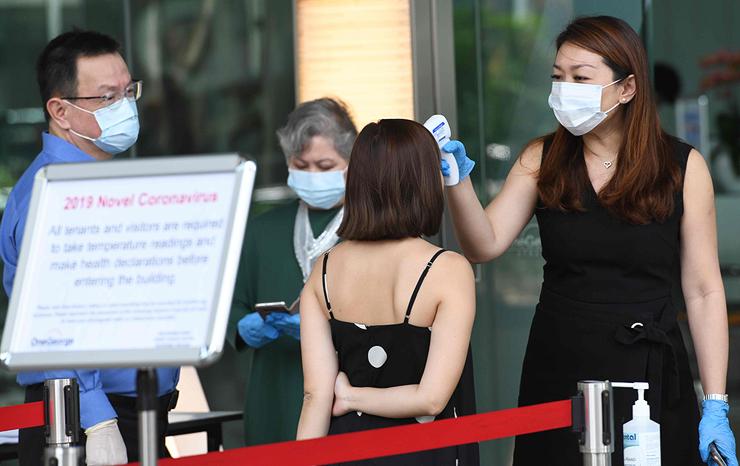 סינגפור: סגר מלא, בדיקות המוניות ותושבים ממושמעים