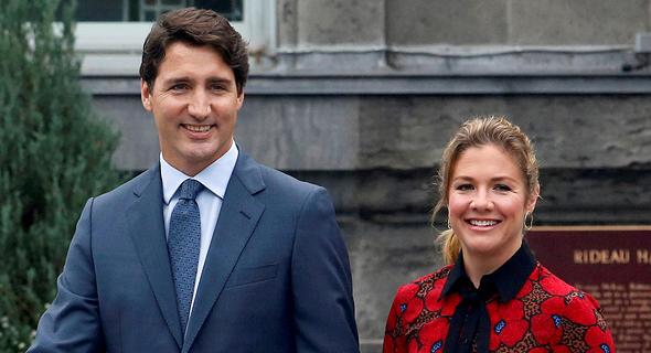 ראש ממשלת קנדה ג'סטין טרודו ורעייתו סופי. אובחנו כחולים בנגיף