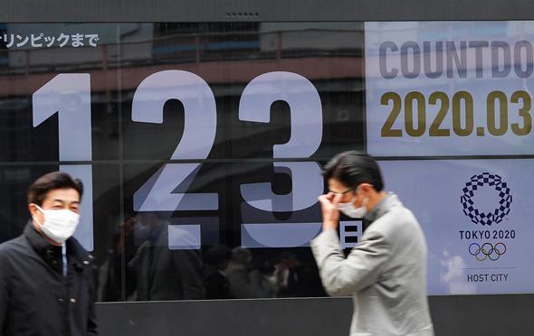 אזרחים מסכות שלט אולימפיאדה אולימפיאדת טוקיו 2020 יפן, צילום: רויטרס