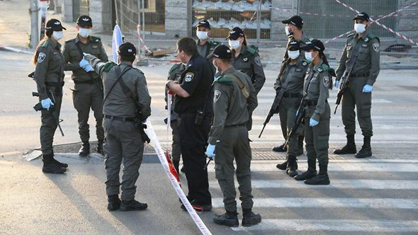 Police officers in Bnei Brak during the Covid-19 outbreak. Photo: Israel Police Spokesperson