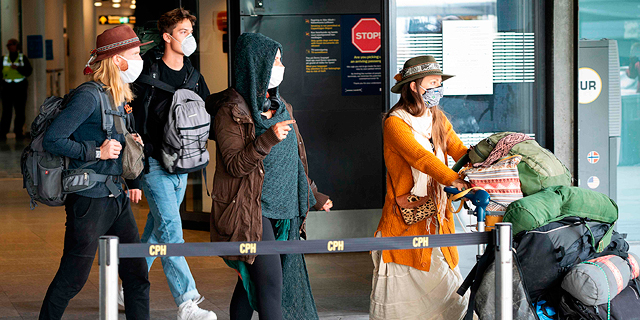 תושבים חוזרים ל דנמרק שדה התעופה ב קונפנהגן  קורונה וירוס, צילום: איי אף פי