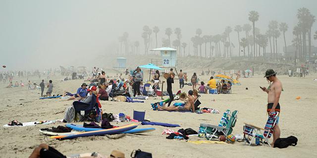 חוף היום הנטינגטון סיטי, קליפורניה, השבוע, צילום: רויטרס