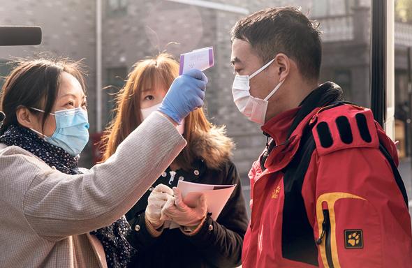 בדיקות חום בסין, צילום: בלומברג