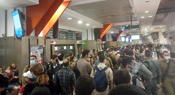 A large gathering of people in the Jerusalem Central Bus Station. Photo Souf Patishi