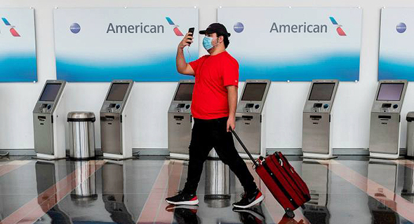 A passenger walks towards the check-in counter. Photo: AFP