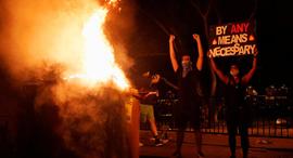"""מהומות ב ארה""""ב עוצר לילי, צילום: רויטרס"""