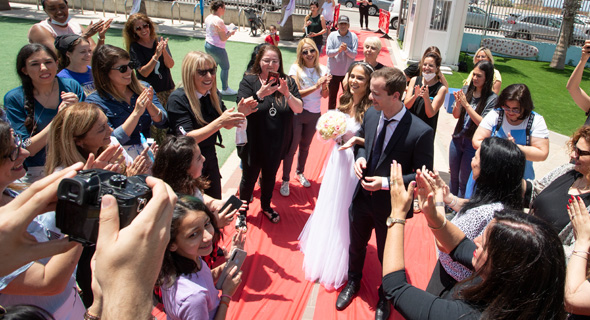 Weddings were limited to 50 guests under Covid-19 regulations. Photo: Gil Nechoshtan