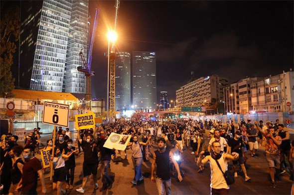 Protesters took to the streets in Tel Aviv on Saturday night. Photo: Tal Shachar