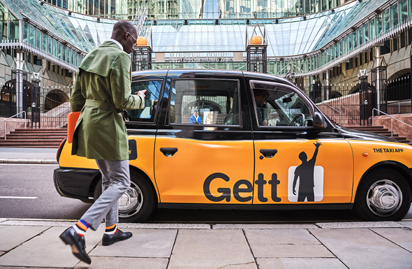A man enters a Gett vehicle. Photo: Gett