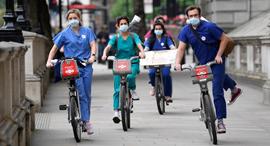 קורונה לונדון בריטניה אחיות אחים בית חולים , צילום: רויטרס