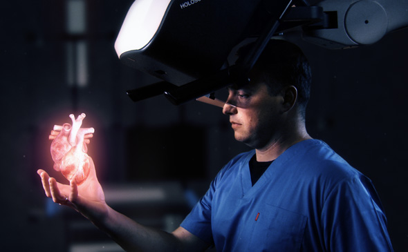 A person looking at a hologram of a human heart. Photo: RealView Imaging