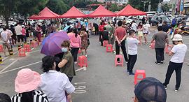 קורונה סין העיר דאליאן Dalian בדיקות לקורונה, צילום: איי אף פי