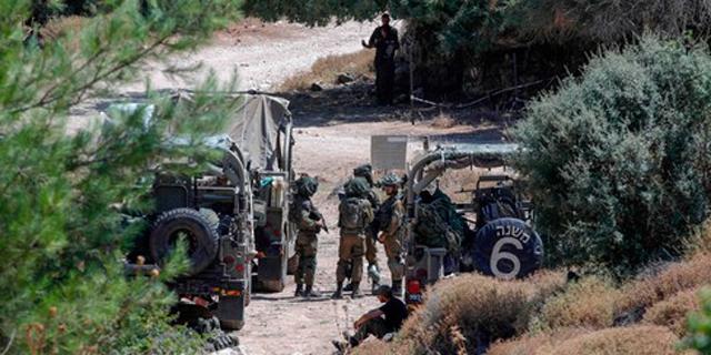 """פריסת כוחות צה""""ל בגבול לבנון, צילום: AFP"""