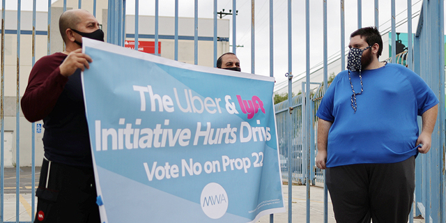 נהגי אובר וליפט מפגינים בעד הכרה בהם כשכירים, צילום: רויטרס