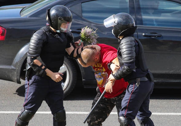 Police arrest a protester in Minsk. Photo: IPA