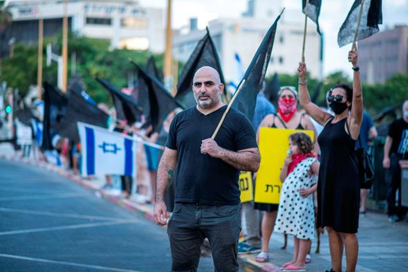 אלון מזרחי בהפגנה, צילום: יובל חן