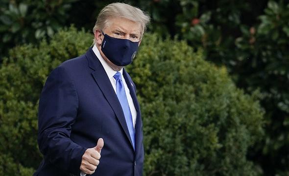 דונלד טראמפ בדרך למסוק הנשיאותי בבית החולים וולטר ריד ליד וושינגטון בדרך לאשפוז, צילום: גטי אימג