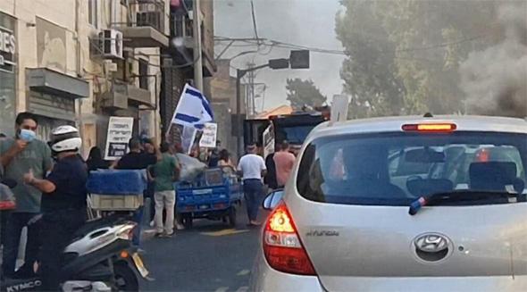 בעלי עסקים שורפים סחורה בתל אביב, היום