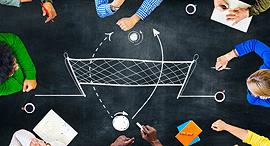 Team members debate company strategy. Photo: Shutterstock