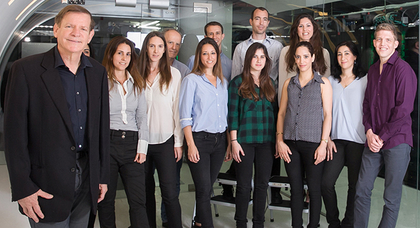Infinidat founder Moshe Yanay (left) and company employees. Photo: Orel Cohen