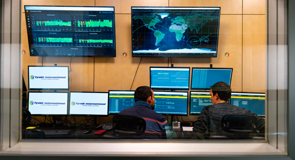 Employees at the operations center in Turin, Italy monitor satellites