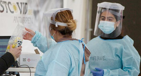 בדיקת קורונה באנטוורפן ,בלגיה, צילום: איי פי