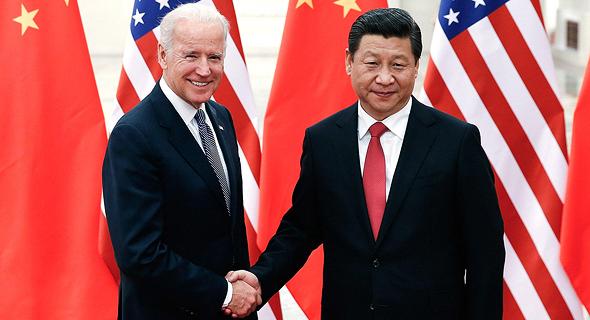 """מימין: נשיא סין שי ג'ינפינג ונשיא ארה""""ב ג'ו ביידן. מחיר מלחמת הסחר"""