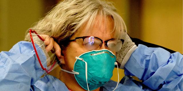 אחות במרכז בדיקות קורונה בצפון דקוטה, צילום: רויטרס