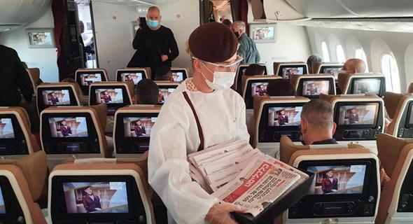 במטוס בדרך לדובאי, צילום: אוראל כהן