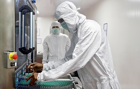 Scientists working on a Covid-19 vaccine at AstraZeneca Labs. Photo: Reuters