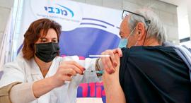 חיסון קורונה במכבי, צילום: איי אף פי