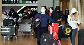 """נתב""""ג טיסות נכנסות חוזרים מחו""""ל קורונה, צילום: יריב כץ"""