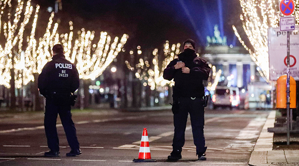 Police officers enforce the curfew in Berlin on new Year
