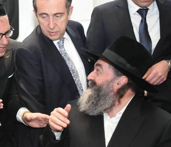 Moises Gertner (standing in center) with Rabbi Yekutiel Abuhatzeira (sitting). Photo: Yossi Weiss/Hadri Haredim