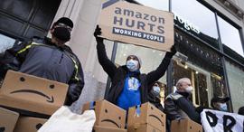 הפגנה עובדי אמזון , צילום: אי פי איי