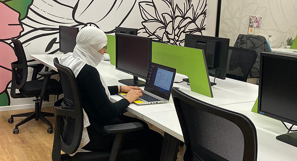 A female Druze programmer works in the Lotus hub's shared office space. Photo: Maysa Halabi Alsheikh