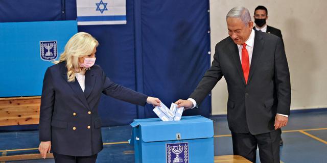 בנימין ושרה נתניהו מצביעים, צילום: איי אף פי