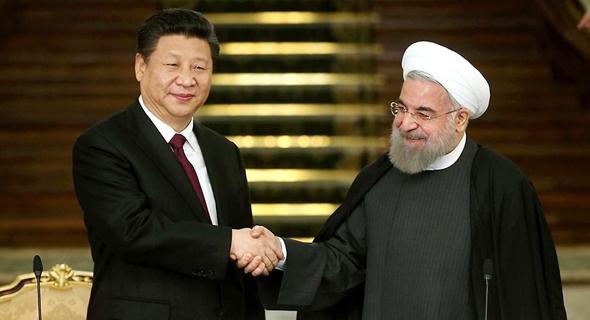 מימין: נשיא איראן חסן רוחאני ונשיא סין שי ג