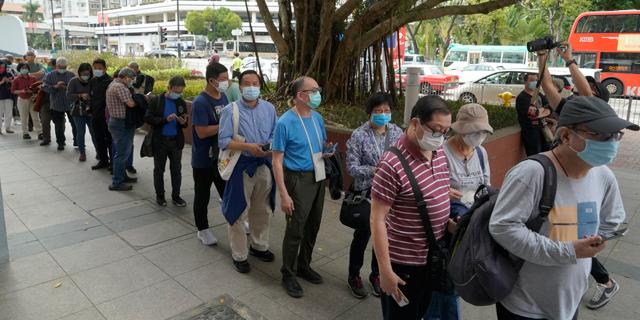 מרכז חיסונים לקורונה בהונג קונג, צילום: איי פי