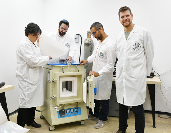 The Helios team in the lab testing out their technology. Photo: Haya Gold